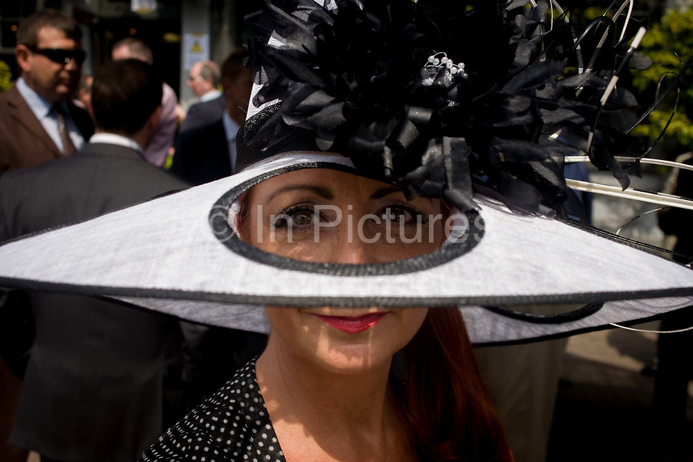 The milliner Liz Felix wearing one of her own creations<br /> during the annual Royal Ascot horseracing festival in Berkshire, England. Royal Ascot is one of Europe's most famous race meetings, and dates back to 1711. Queen Elizabeth and various members of the British Royal Family attend. Held every June, it's one of the main dates on the English sporting calendar and summer social season. Over 300,000 people make the annual visit to Berkshire during Royal Ascot week, making this Europe's best-attended race meeting with over £3m prize money to be won.