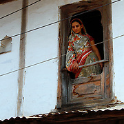 A Nisarpuri woman observes the town's guests in the street outside her home, which will soon be underwater if plans to raise the Narmada dam's height go ahead.