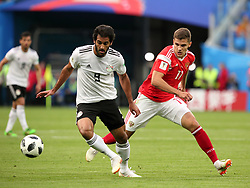 June 19, 2018 - St. Petersburg, Russia - 19 June 2018, Russia, St. Petersburg, FIFA World Cup 2018, First Round, Group A, First Matchday, Russia v Egypt. Player of the national team Marwan Mohsen (9), Roman Zobnin  (Credit Image: © Russian Look via ZUMA Wire)