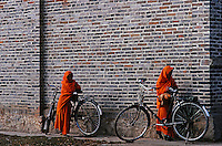 Two Young hinayanan monks with their bikes