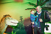 NO FEE PICTURES<br /> 17/12/17 Gareth Chaney and son Darragh 1 8mths, Clondalkin pictured at the prehistoric preview and official opening of Dinosaurs Around The World now open at the the Ambassador Theatre  for a limited time only. Embark on a globetrotting expedition around the world to discover the Age of Reptiles! With advanced animatronics, a multi-layered narrative, fossils, authentic casts, cutting-edge research and immersive design elements you'll experience the Age of Reptiles as it comes to life!  Dinosaurs Around the World is open daily to the public from 10 a.m. with last entry at 6pm for a limited time only. Tickets available from Ticketmaster.ie and from the Ambassador Theatre Box Office now. Visit www.mcd.ie for more. Pictures: Arthur Carron