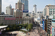 "Nanjing East RoadShoppers fill the Nanjing Road Pedestrian Street on a weekend in Shanghai, China on 30 October 2013.  The road is dubbed as ""China's Main Street"" as it has been the city's shopping and tourism center ever since the 1920's."
