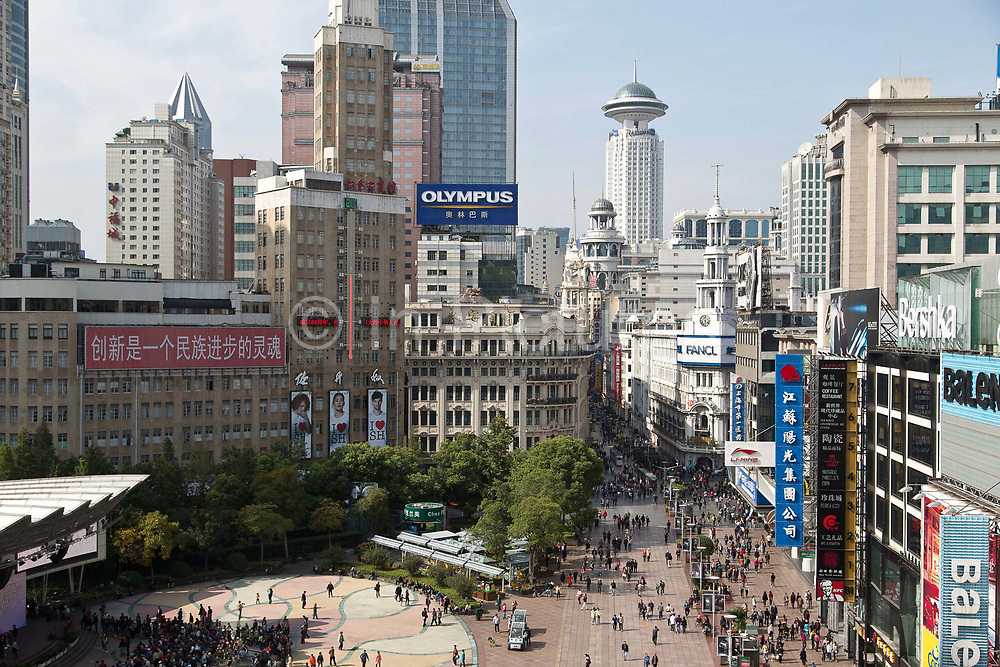 """Nanjing East RoadShoppers fill the Nanjing Road Pedestrian Street on a weekend in Shanghai, China on 30 October 2013.  The road is dubbed as """"China's Main Street"""" as it has been the city's shopping and tourism center ever since the 1920's."""