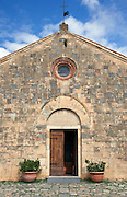 A church on the main sqaure of the medieval, hilltop town of Monteriggioni in Tuscany, Italy