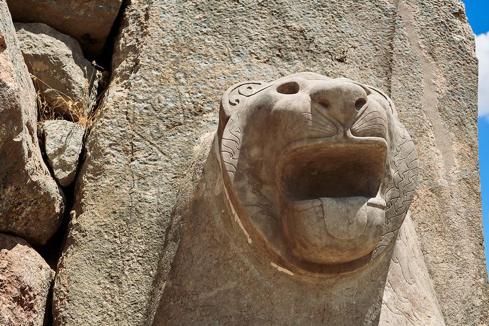 Picture & image of the Hittite lion sculpture of the Lion Gate. Hattusa (also Ḫattuša or Hattusas) late Anatolian Bronze Age capital of the Hittite Empire. Hittite archaeological site and ruins, Boğazkale, Turkey.