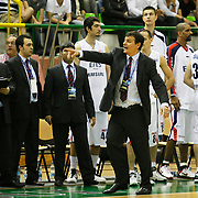 Efes Pilsen's coach Ergin ATAMAN (C) during their Turkish Basketball league Play Off Final second leg match Efes Pilsen between Fenerbahce Ulker at the Ayhan Sahenk Arena in Istanbul Turkey on Saturday 22 May 2010. Photo by Aykut AKICI/TURKPIX