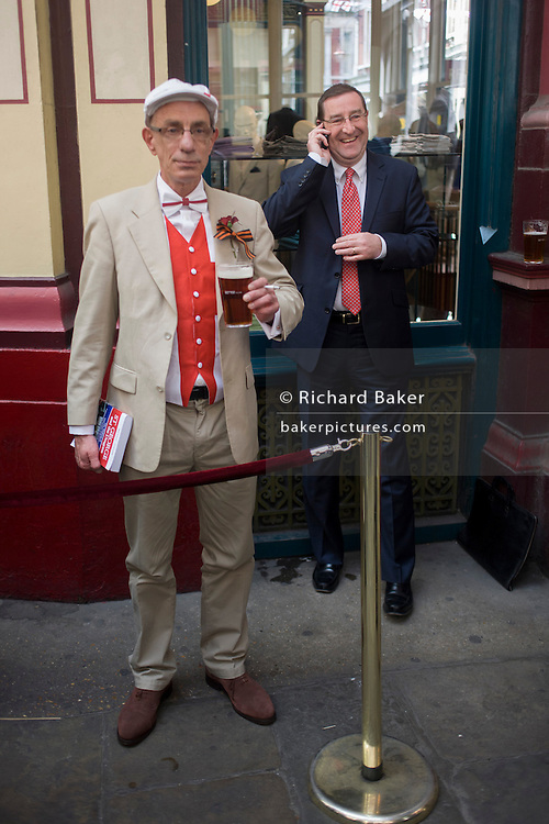 Lunchtime drinkers wearing red in Leadenhall Market on St George's Day, when 'Englishmen' celebrate their patron saint.