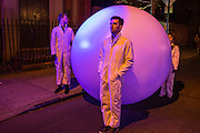 Handlers from Snarkitecture stand by an inflated ball on Mulberry Street as a performance in the Ideas City festival.