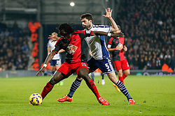 Bafetibis Gomis of Swansea City is challenged by Claudio Yacob of West Brom - Photo mandatory by-line: Rogan Thomson/JMP - 07966 386802 - 11/02/2015 - SPORT - FOOTBALL - West Bromwich, England - The Hawthorns - West Bromwich Albion v Swansea City - Barclays Premier League.
