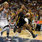 Odyssey Sims, Tulsa Shock, drives to the basket past Katie Douglas, Connecticut Sun, during the Connecticut Sun Vs Tulsa Shock WNBA regular season game at Mohegan Sun Arena, Uncasville, Connecticut, USA. 3rd July 2014. Photo Tim Clayton