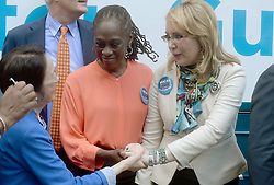 Gun violence victim and former U.S. Congresswoman Gabby Giffords, alongside New York's First Lady Chirlane McCray, during a visit to City Hall on her 2016 Vocal Majority Tour on October 17, 2016 in New York City, NY, USA. Giffords, along with her husband NASA astronaut Mark Kelly, are on a six-week, nationwide bus tour to battleground states asking people to vote for candidates who support gun violence prevention legislation in this coming November election. The Vocal Majority Tour is a project of their national organization, Americans for Responsible Solutions PAC. Giffords, who has made a dramatic recovery, survived an assassination attempt in 2011 near Tucson, Arizona. Photo by Dennis Van Tine/ABACAPRESS.COM