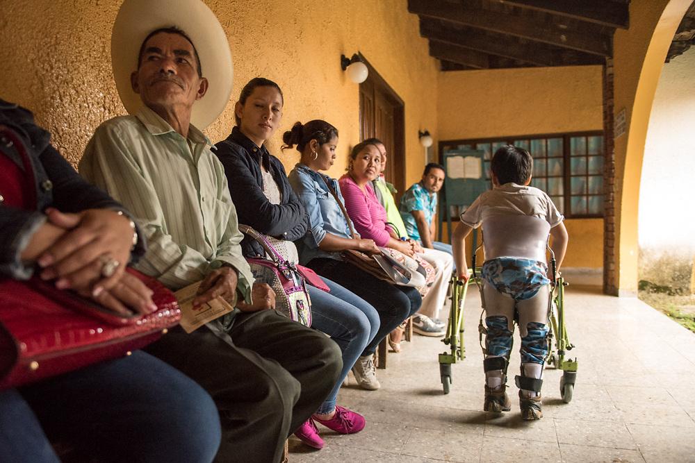 Dr. AJ Rubato, Chiropractor and assistant Iris Hess, work on patients at Teleton October 19, 2016 in Santa Rosa de Copan, Copan, Honduras. Photo Ken Cedeno