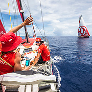 Leg 6 to Auckland, day 15 on board MAPFRE, Sophie Ciszek waving Dongfeng, Blair Tuke on deck as well. 21 February, 2018.