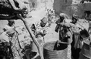 NIGER. Bouza. 21/01/1987: Water chore at the village well.