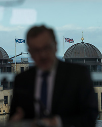 """At First Minister's Questions, Scottish Conservative leader Ruth Davidson said the party would reject the proposals set out by the SNP on Monday.<br /> <br /> Scottish Conservative leader Ruth Davidson was joined by Scotland Minister David Mundell in Edinburgh. She said, <br /> <br /> """"The Scottish Conservatives reject the proposals set out by the First Minister on Monday.<br /> <br /> """"A referendum cannot happen when the people of Scotland have not been given the opportunity to see how our new relationship with the European Union is working.<br /> <br /> """"And it should not take place when there is no clear political or public consent for it to happen.<br /> <br /> """"Our country does not want to go back to the divisions and uncertainty of the last few years.<br /> <br /> """"Another referendum campaign will not solve the challenges this country will face.<br /> <br /> """"We don't want it. We don't need it.""""<br /> <br /> <br /> Pictured: David Mundell with a Saltire and Union Flag flying either side of his head"""
