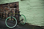 Green colour coordinated bike 20th September 2019 parked in the trendy neighbourhood of Grunerlokka in Oslo. Once outlawed and stigmatized, street art has become more than welcome in Oslo over the last decade, turning the city into a blossoming outdoor gallery sprinkled with both local and international works of art.