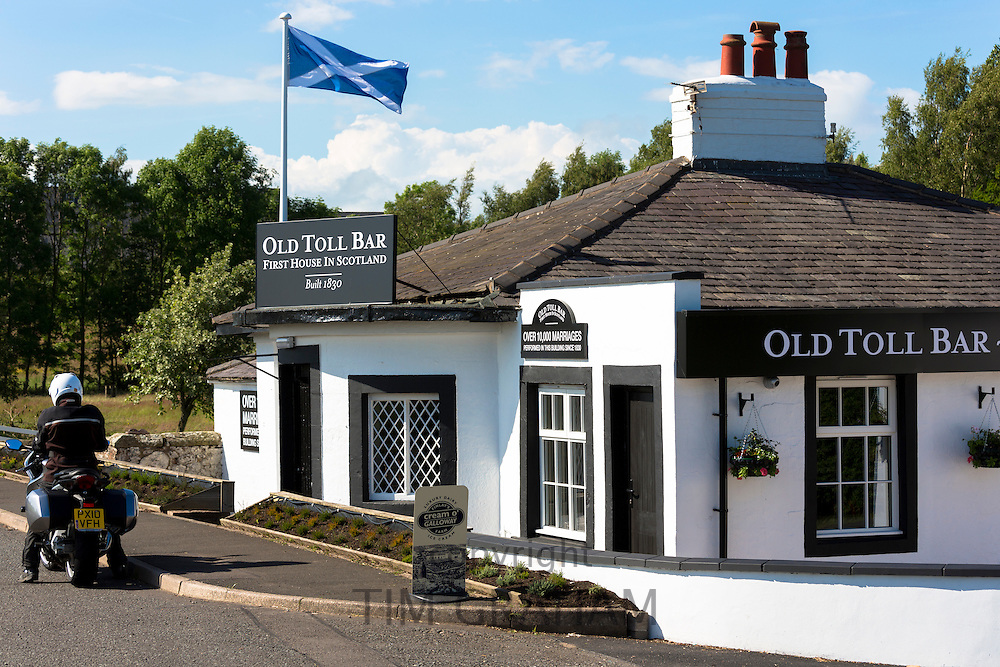 Scottish flag, the Saltire, on the First House in Scotland on the Scottish/English border at Gretna
