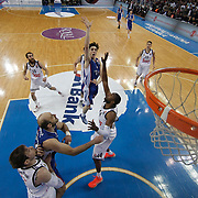 Anadolu Efes's Cedi Osman (C) and Real Madrid's Markus Slaughter (F) during their Turkish Airlines Euroleague Basketball PlayOffs Round 4 match Anadolu Efes between Real Madrid at Abdi ipekci arena in Istanbul, Turkey, Thursday April 23, 2015. Photo by Aykut AKICI/TURKPIX