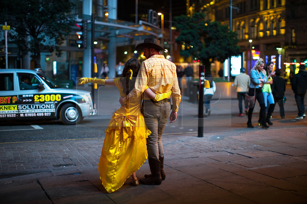 © Licensed to London News Pictures . 07/04/2017 . Manchester , UK . A Disney themed pub crawl passes through The Printworks on Withy Grove in Manchester City Centre . Greater Manchester Police have authorised dispersal powers and say they will ban people from the city centre for 48 hours , this evening (7th April 2017) , in order to tackle alcohol and spice abuse . Photo credit : Joel Goodman/LNP