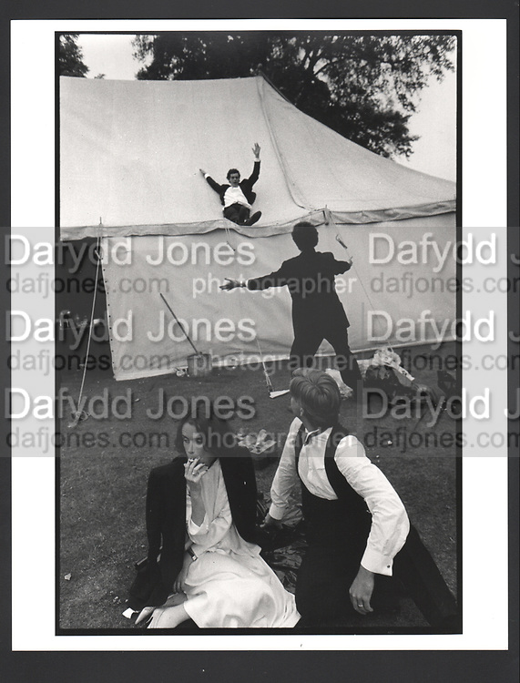 Sliding down the marquee during the New College May Ball. Oxford. 24 June 1983 Exhibition in a Box