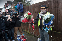 © Licensed to London News Pictures. 11/04/2018. London, UK. A man who gave his name as Iain Gordon talks to reporters as he removes all the floral tributes from near the house of Richard Osborn-Brooks. Henry Vincent was killed as he burgled the home of 78 year old Richard Osborn-Brooks. Mr Osborn-Brooks was arrested for murder but later released without charge. Friends and family of Henry Vincent have had floral tributes they placed near the scene repeatedly torn down by locals. Photo credit: Peter Macdiarmid/LNP