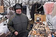 Yekaterinburg, Russia, 02/04/2006..Viktor Shkola selling whatever he can at Shartashky Market.
