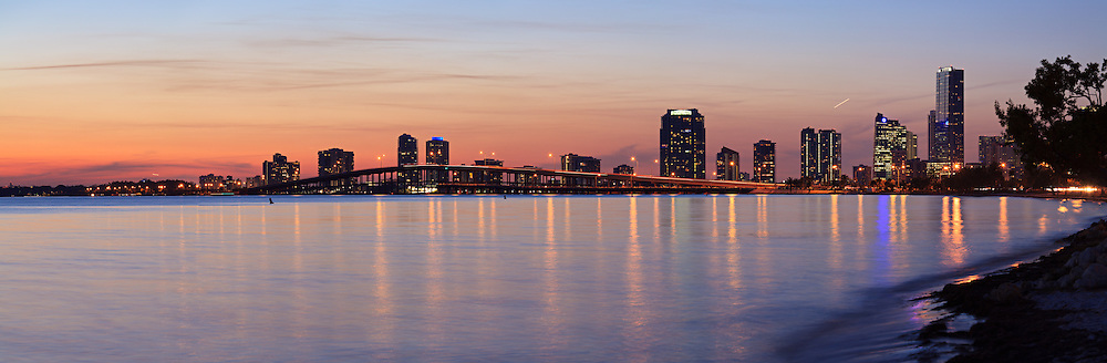 Panoramic view of the William Powell Bridge and Rickenbacker Causeway at dusk with condominium and office buildings on Miami's Brickell Avenue in the background. WATERMARKS WILL NOT APPEAR ON PRINTS OR LICENSED IMAGES.