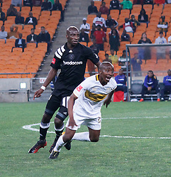 Thamsanqa Mkhize of Cape Town City and Musa Nyatama in a match between Orlando Pirates  and Cape Town City at  Fnb Stadium on Tuesday September 19, 2017.