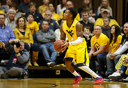 Feb 24, 2018; Morgantown, WV, USA; West Virginia Mountaineers guard Daxter Miles Jr. (4) shoots a three pointer during the first half against the Iowa State Cyclones at WVU Coliseum. Mandatory Credit: Ben Queen-USA TODAY Sports