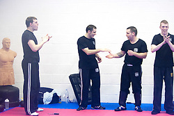 Students react to finishing the International Krav Maga Federation (IKMF) Civilian Instructor Course (CIC) part 3 at the Scottish Martial Arts Centre, Alloa. .©2011 Michael Schofield. All Rights Reserved.