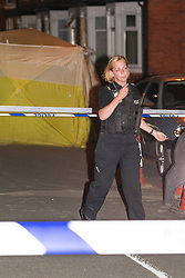 © Licensed to London News Pictures . FILE PICTURE DATED 11/07/2013 of police at the scene on Beard Road , Gorton , Greater Manchester where 23 year old Jordan Begley died following an incident in which he was tasered by police . The inquest is taking place today ( 1st June 2015 ) at Manchester Civil Justice Centre . Photo credit : Joel Goodman/LNP