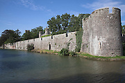 Wall and moat of Bishop's Palace, Wells, Somerset, England