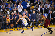 Golden State Warriors guard Stephen Curry (30) pushes the ball down court after stealing it from Cleveland Cavaliers forward LeBron James (23) at Oracle Arena in Oakland, Calif., on January 16, 2017. (Stan Olszewski/Special to S.F. Examiner)