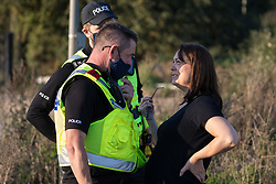 West Hyde, UK. 14th September, 2020. Hertfordshire Police officers ask a local resident to move away from a site where environmental activists from HS2 Rebellion had blocked a gate to a site for the Chiltern Tunnel on the route of the HS2 high-speed rail link. Anti-HS2 activists blocked two gates to the South Portal site for the controversial £106bn rail line, one for over six hours and the other for over nineteen hours.