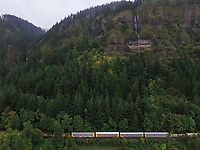 Aerial view of a train crossing the forest in Oregon, USA.