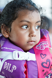 Portrait of young girl in life jacket at the Panther Island Pavilion, Trinity River, Fort Worth, Texas, USA.
