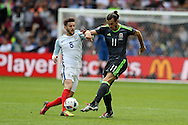 Gareth Bale of Wales ® in action with Adam Lallana of England. .Euro 2016, group B , England v Wales at Stade Bollaert -Delelis  in Lens, France on Thursday 16th June 2016, pic by  Andrew Orchard, Andrew Orchard sports photography.