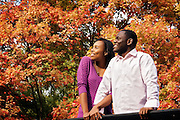 Happy couple enjoying the colours of autumn.