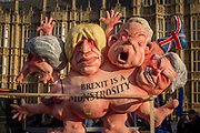 As Prime Minister Theresa May tours European capitals hoping to persuade foreign leaders to accept a new Brexit deal following her cancellation of a Parliamentary vote, pro-EU Remainers protest with satirical figures of Theresa May, Boris Johnson, Michael Gove and David Davies, opposite the Houses of Parliament, on 11th December 2018, in London, England.