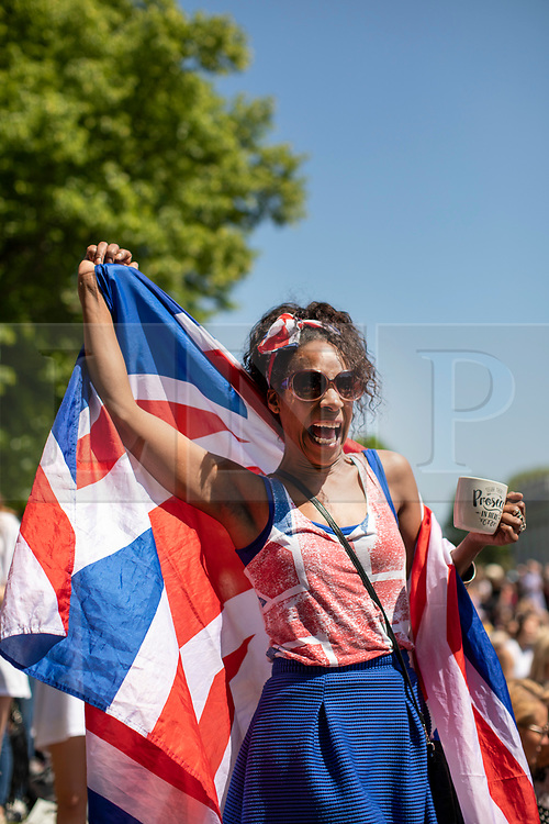 © Licensed to London News Pictures. 19/05/2018. London, UK. Well-wishers celebrate the Royal Wedding at an outdoor screening at the National Maritime Museum in Greenwich. Prince Harry is getting married to Meghan Markle today in Windsor. Photo credit: Rob Pinney/LNP