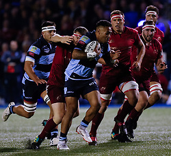 Willis Halaholo of Cardiff Blues under pressure from Mike Sherry of Munster<br /> <br /> Photographer Simon King/Replay Images<br /> <br /> Guinness PRO14 Round 4 - Cardiff Blues v Munster - Friday 21st September 2018 - Cardiff Arms Park - Cardiff<br /> <br /> World Copyright © Replay Images . All rights reserved. info@replayimages.co.uk - http://replayimages.co.uk