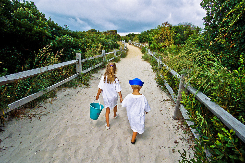 Children head to the beach at Avalon on the Jersey Shore, where intact dunes protect the island.