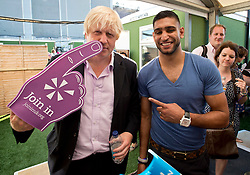© Licensed to London News Pictures. 19/07/2013. London, United Kingdom. London Mayor Boris Johnson and Boxer Amir Khan at Go Local to encourage a new drive in volunteering one year on from the Games. The event is a star-studded celebration of volunteering, co-hosted by Join In, the London 2012 legacy charity for volunteering and Team London, the volunteering initiative of the Mayor of London. Photo credit : Justin Setterfield/LNP