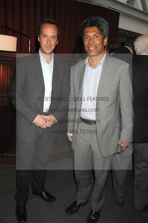 Left to right, owners of the Conran Restaurant group DAVID LOEWI and DES GUNEWARDENA at a party to celebrate the publication of Nain Attallah's book'Fulfilment & Betrayal' held at The Bluebird, King's Road, London on 1st May 2007.<br />