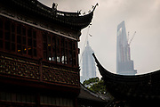 Jin Mao Tower framed by the roof of the Huxinting Teahouse in Yu Yuan Gardens Shanghai, China