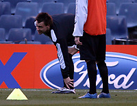 Photo: Chris Ratcliffe.<br />Chelsea Training Session. UEFA Champions League. 06/03/2006. <br />Chelsea's John Terry rubs his ankle after showing signs of an injury.