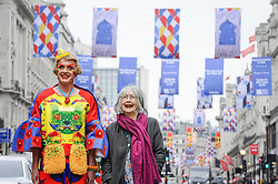 © Licensed to London News Pictures. 04/06/2018. London, UK.  Grayson Perry RA and Rose Wylie RA pose at a photocall to celebrate the 250th anniversary of the Royal Academy's Summer Exhibition where over 200 flags, designed by celebrated Royal Academicians, decorate the streets of the West End.  Photo credit: Stephen Chung/LNP