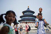 A Chinese family smile on the pavillion of the Temple of Heaven, literally the Altar of Heaven (simplified Chinese: 天坛 ; pinyin: Tiāntán) in Beijing, China, July 20, 2014.<br /> <br /> Confucianism, Taoism and Buddhism are the three major religions in China. Temples and statues witness their ancient roots all over the Chinese country.<br /> <br /> © Giorgio Perottino
