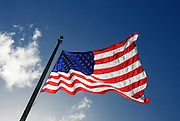 Picture of an American flag waving in the wind.