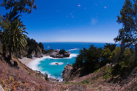 The full moon lights up the waterfall and cove at Julia Pfeiffer Burns State Park, Big Sur, California.
